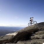 Mountain biking enthusiast executing a climb
